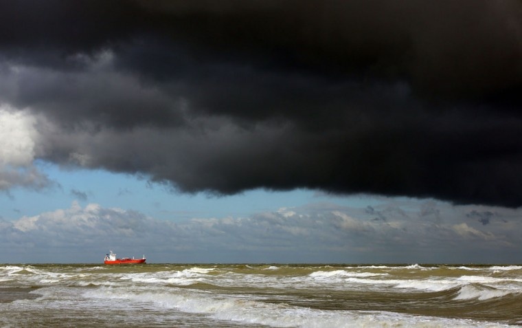 A ship is moored seeking shelter beneath stormy skies in the English Channel off the coast of Margate, south eastern England, Wednesday Oct. 14, 2015. Britain's weather is turning colder as autumnal storms head for the island. (Gareth Fuller/PA via AP)