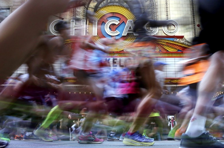 Runners participate in the Chicago Marathon, Sunday, Oct. 11, 2015, in Chicago. (AP Photo/Nam Y. Huh)