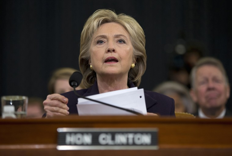 Democratic presidential candidate, former Secretary of State Hillary Rodham Clinton, looks toward the dais as she settles into her seat on Capitol Hill in Washington on Thursday prior to testifying before the House Benghazi Committee. (Evan Vucci/AP)