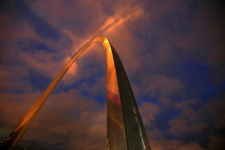 The Gateway Arch is lit with golden-colored lights just before sunrise, Wednesday, Oct. 28, 2015, in St. Louis. The city is celebrating the moment when the final piece of the 630-foot-tall structure was put into place on Oct. 28, 1965. (David Carson/St. Louis Post-Dispatch via AP)