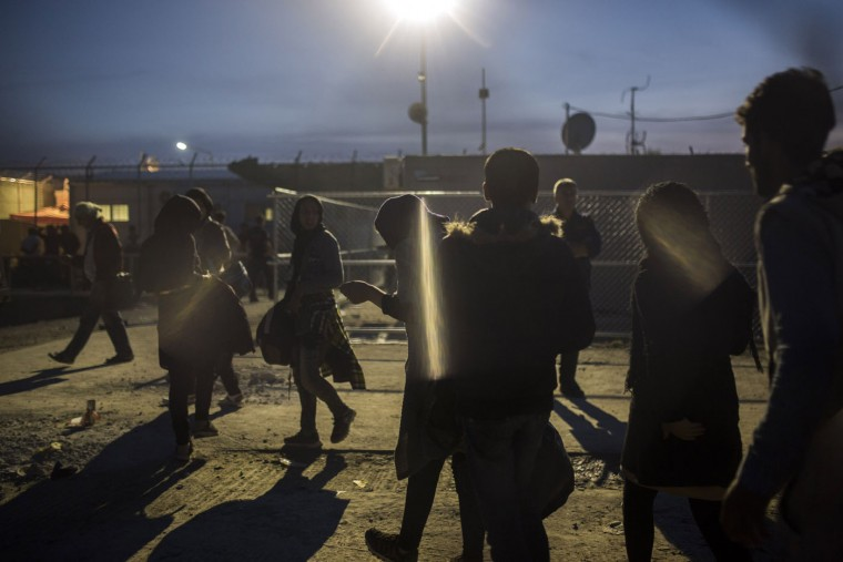 Migrants walk outside a processing center in Moria village on the northeastern Greek island of Lesbos, Tuesday, Oct. 20, 2015. Two international agencies say over a half million asylum-seekers have reached Greece this year. The European Union's border agency says that members of the bloc have agreed to provide 291 border guards to be deployed immediately to Greece and Italy to help identify and register migrants. (AP Photo/Santi Palacios)