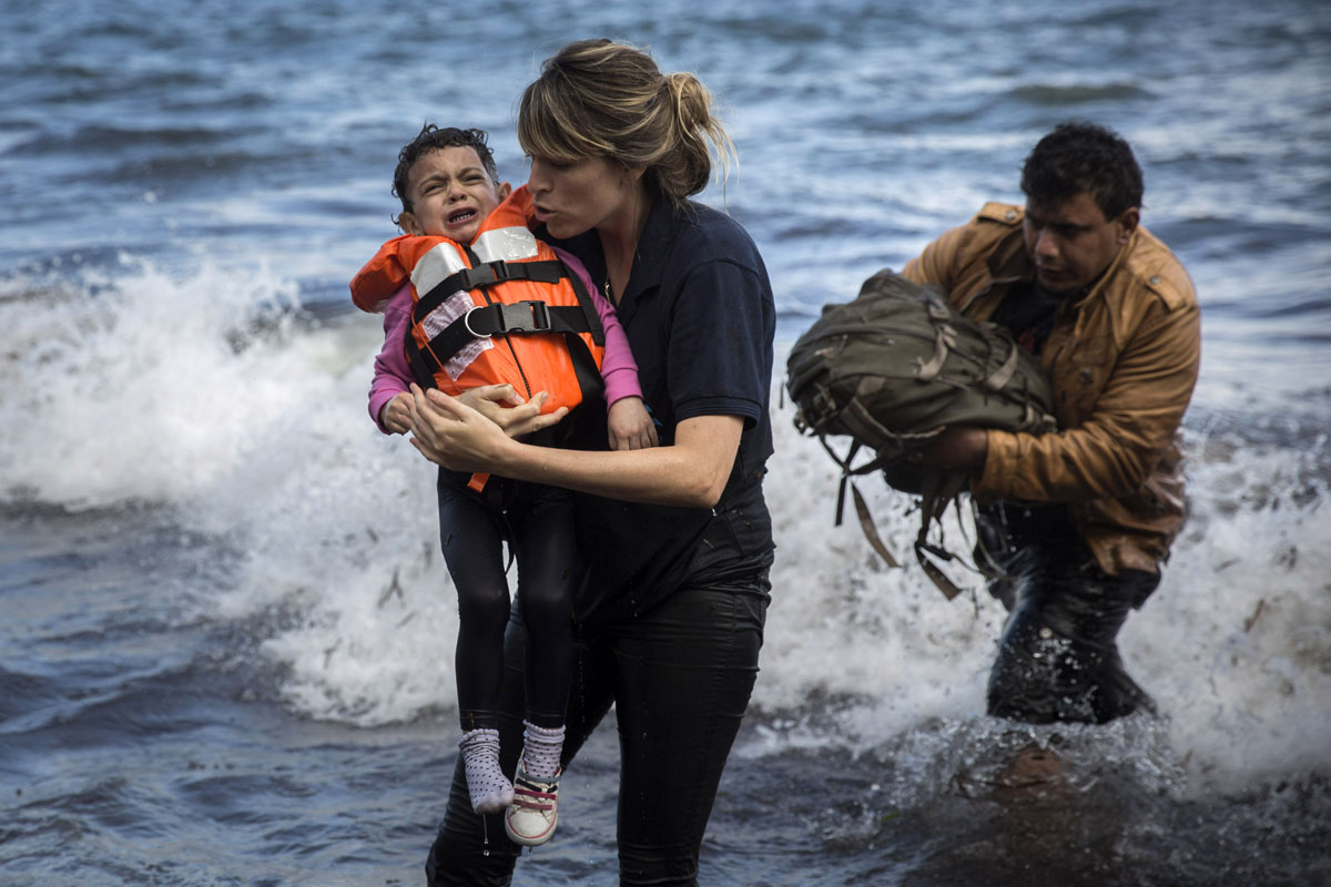 Syrian refugees land on Greek island of Lesbos