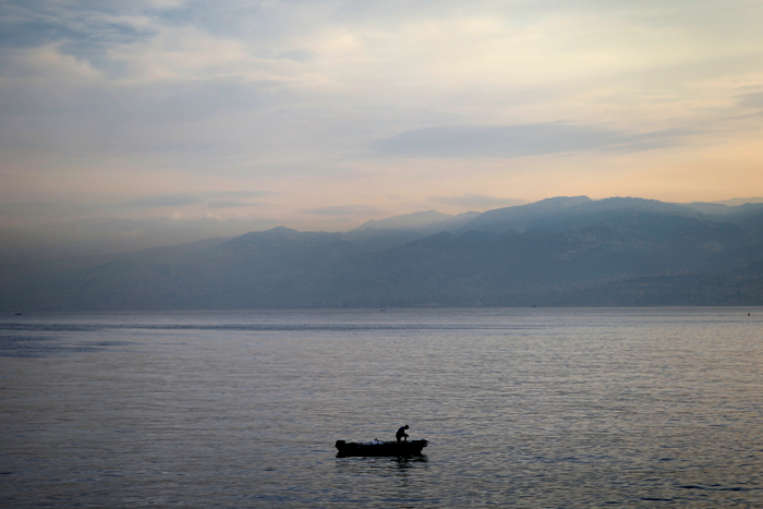 A Lebanese man fishes along the Beirut coastline as the sun rises over the Mediterranean Sea in Lebanon on Tuesday. (Hassan Ammar/AP)
