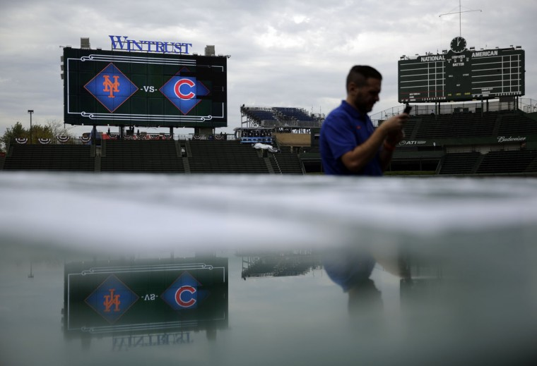 A worker sets up at Wrigley Field before Game 3 of the National League baseball championship series between the New York Mets and the Chicago Cubs, Tuesday, Oct. 20, 2015, in Chicago. (AP Photo/David Goldman)