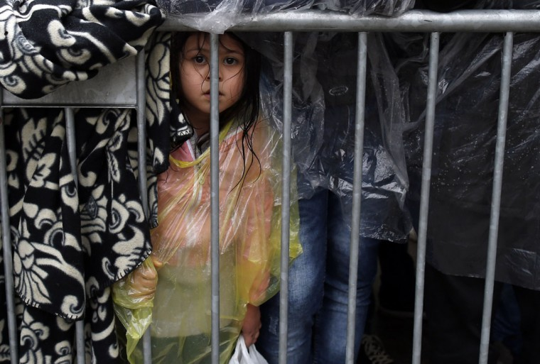 A migrants girl waits to register with the police at a refugee center in the southern Serbian town of Presevo, Wednesday, Oct. 7, 2015. Several Eastern European countries are cooperating on controlling the flow of migrants at the external borders of the European Union ó a program a top Hungarian official said Tuesday could set an example for the rest of the 28-nation bloc. (AP Photo/Darko Vojinovic)