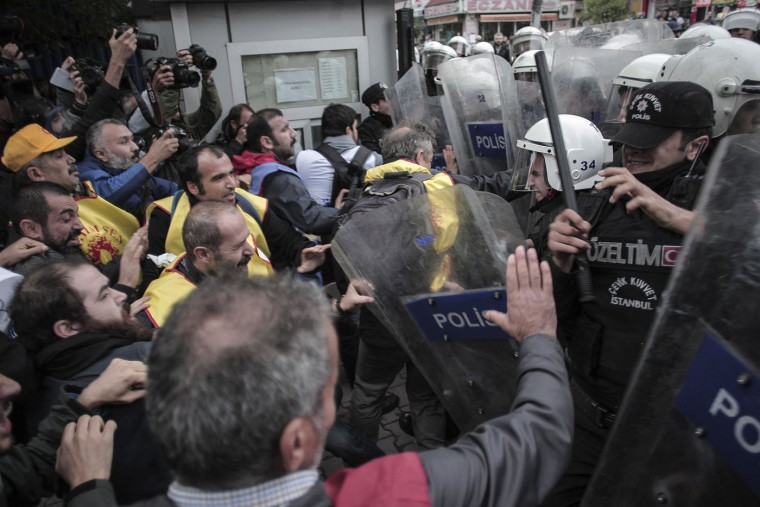 Protesters clash with police in Istanbul, Turkey, Tuesday, Oct. 13, 2015. Scuffles broke out after authorities in Istanbul banned a protest rally and march by the same trade union and civic society groups who lost friends and colleagues in Turkey's bloodiest terror attack in Ankara on Oct. 10, 2015. The two suicide bombings in the capital came amid political uncertainty in the country — just weeks before Turkey's Nov. 1 election. (AP Photo/Cagdas Erdogan)