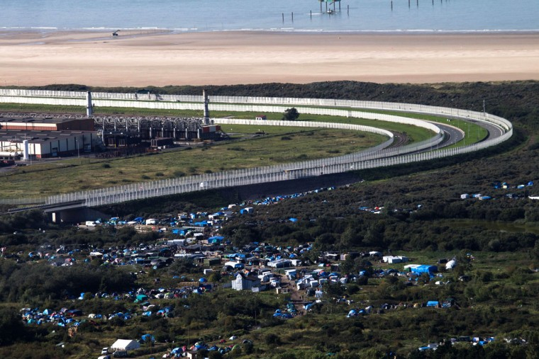 An aerial view of the migrant camp known as the New Jungle Camp, near to Calais, northern France, Friday, Sept. 25, 2015, with the English Channel in background. (AP Photo/Michel Spingler)