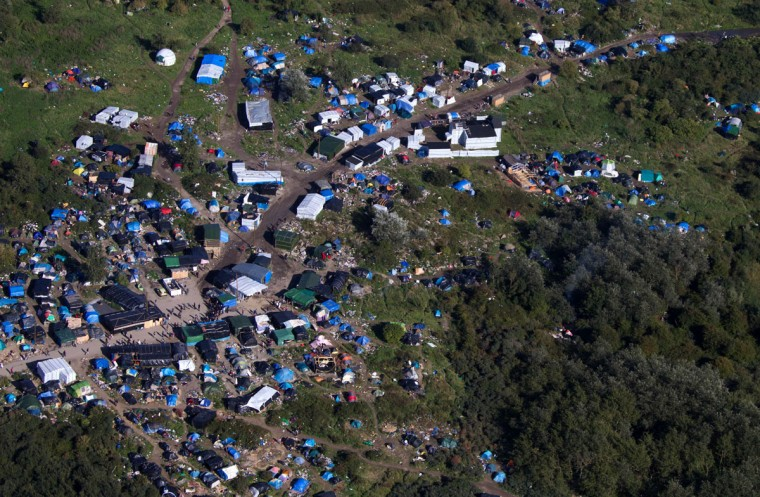 An aerial view of the migrant camp known as the New Jungle Camp, near to Calais, northern France, Friday, Sept. 25, 2015. (AP Photo/Michel Spingler)