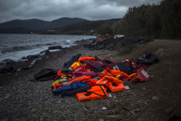 Life jackets used by refugees and migrants are piled up on a beach on the northeastern Greek island of Lesbos, Wednesday, Sept. 30, 2015. Authorities in Greece say 2 people have died and 47 people have been rescued from a dinghy near the island on Wednesday. Lesbos is the busiest entry point for migrants reaching the European Union, with some 2,000 arrivals per day from nearby Turkey. (AP Photo/Santi Palacios)