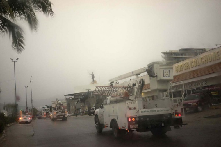 "Trucks belonging to Mexico's Federal Electricity Commission (CFE) drive down a road in the Pacific resort city Puerto Vallarta, Mexico, Friday, Oct. 23, 2015. Hurricane Patricia barreled toward southwestern Mexico Friday as a monster Category 5 storm, the strongest ever in the Western Hemisphere. Locals and tourists were either hunkering down or trying to make last-minute escapes ahead of what forecasters called a ""potentially catastrophic landfall"" later in the day.  