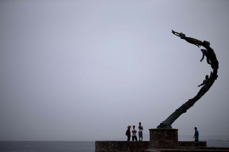 "Residents visit the waterfront in Puerto Vallarta, Mexico, ahead of the arrival of Hurricane Patricia, Friday, Oct. 23, 2015.  Patricia barreled toward southwestern Mexico Friday as a monster Category 5 storm, the strongest ever in the Western Hemisphere. Locals and tourists were either hunkering down or trying to make last-minute escapes ahead of what forecasters called a ""potentially catastrophic landfall"" later in the day. (A  