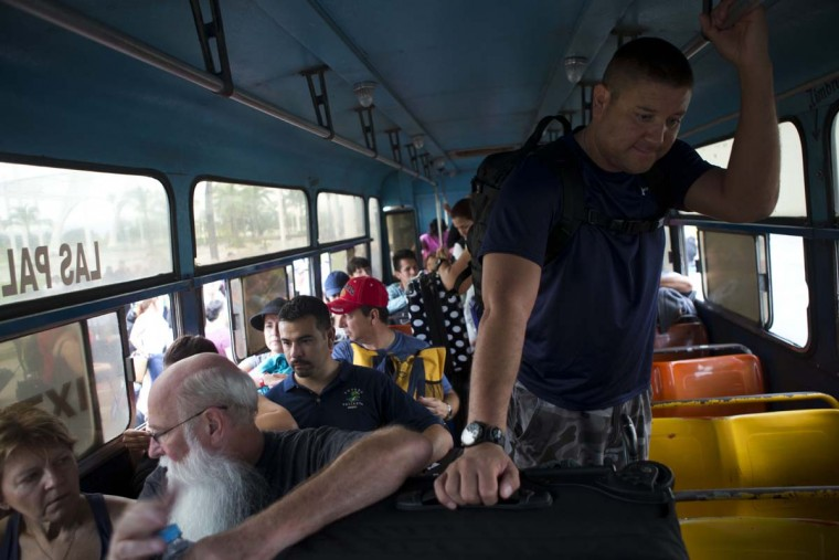 Mexican and international tourists board a bus at a conference center to be transferred to a shelter, bracing for the arrival of Hurricane Patricia in Puerto Vallarta, Mexico, Friday, Oct. 23, 2015. Teams of police and civil protection are walking along Puerto Vallarta's waterfront, advising people to evacuate. A top civil protection official says that three airports in the path of Patricia in southwestern Mexico have been shut down as the storm approaches.  || CREDIT: REBECCA BLACKWELL - AP PHOTO