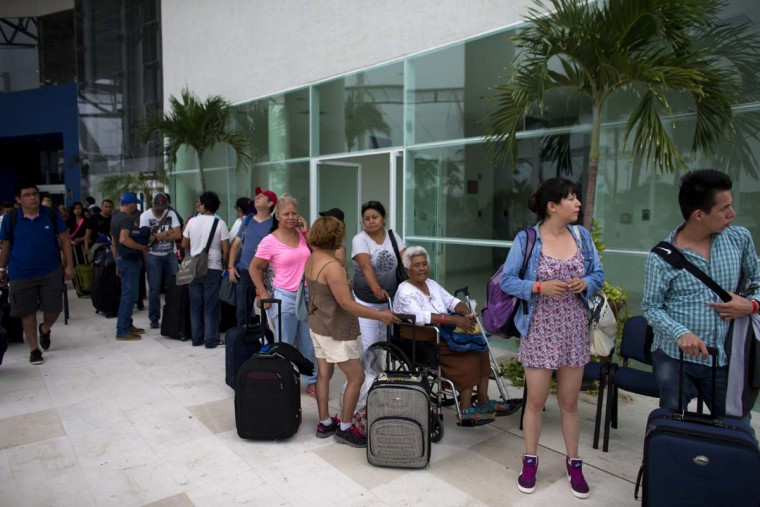 Mexican and international tourists wait for buses to transport them to a shelter ahead of Hurricane Patricia, in Puerto Vallarta, Mexico, Friday, Oct. 23, 2015. The storm is expected to make landfall later Friday.  || CREDIT: REBECCA BLACKWELL - AP PHOTO