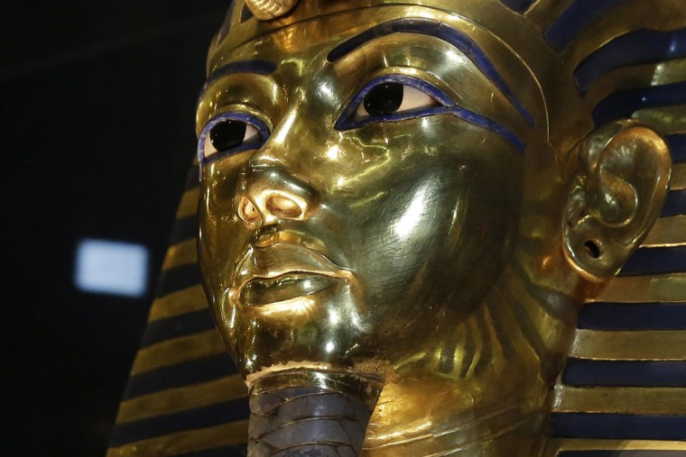 In this Saturday, Jan. 24, 2015, file photo, the gold mask of King Tutankhamun is seen in its glass case during a press tour, in the Egyptian Museum near Tahrir Square, Cairo, Egypt. The restoration of King Tutankhamun's world-famous golden mask will begin Saturday, over a year after the beard was accidentally broken off and hastily glued back with epoxy, Egypt's state-run news agency said Friday. (AP Photo/Hassan Ammar, File)
