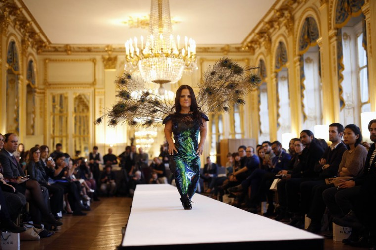 A model hits the catwalk at the French Ministry of Culture during the dwarf fashion show in Paris, France, Friday Oct. 2, 2015. The show is an event organizers say is aimed at highlighting the elitism and prejudice that the model industry encourages in its depiction of bodies. It is presented during the Paris Fashion Week but is not part of it. (AP Photo/Jerome Delay)