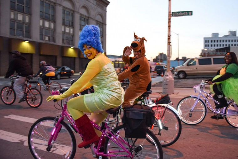 Two riders dress up as Marge Simpson and Scooby Doo for Slow Roll Halloween Monday in Detroit. Thousands of bicyclists rode through the streets of downtown Detroit in their Halloween costumes for the weekly Slow Roll ride. The last roll of the season was shorter than usual, at 7.5 miles, as bicyclists save their energy to dance the night away at The Fillmore for the Slow Roll Halloween party in Detroit. (Tanya Moutzalias/The Saginaw News via AP)