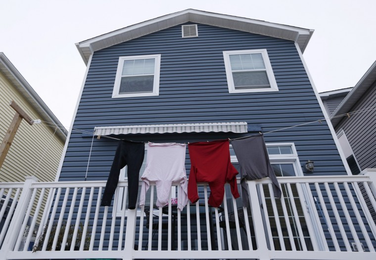 Clothes hang to dry on the railing of a newly constructed home before the third anniversary of Superstorm Sandy in the Breezy Point section of New York, Tuesday, Oct. 27, 2015. According to Breezy Point Cooperative general manager Arthur Lighthall, 220 Breezy Point homes were completely destroyed by flooding from Sandy while another 135 homes burned to the ground during a massive fire ignited by the storm. ìEvery day, itís getting a little bit better,î Lighthall said. (AP Photo/Kathy Willens)