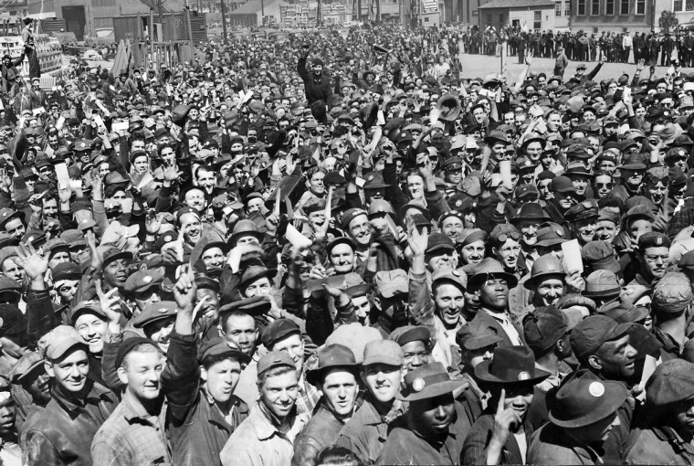 1942 - Bethlehem Steel workers celebrate a triple launching. (A. Aubrey Bodine/Baltimore Sun)