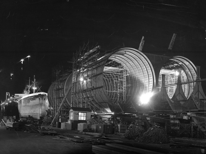 1956 - Come darkness, electric light takes the place of the sun and the port's work goes right ahead. Here, sections of the harbor tunnel are being put together at the Maryland Ship Building plant, Fairfield. (A. Aubrey Bodine/Baltimore Sun)