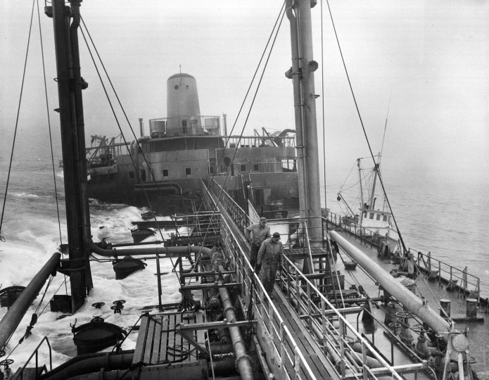 1959 - A view from the bridge of the Liberian tanker African Queen, which on December 31 struck a shoal nine-miles off Ocean City and broke in two. The ship having been formally abandoned, it may legally be stripped. Maryland and Delaware watermen are making hauls. (A. Aubrey Bodine/Baltimore Sun)