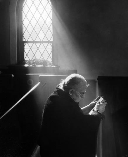 1944 - Mrs. Emma Robinson prays at Parkside Methodist Church. (A. Aubrey Bodine/Baltimore Sun)