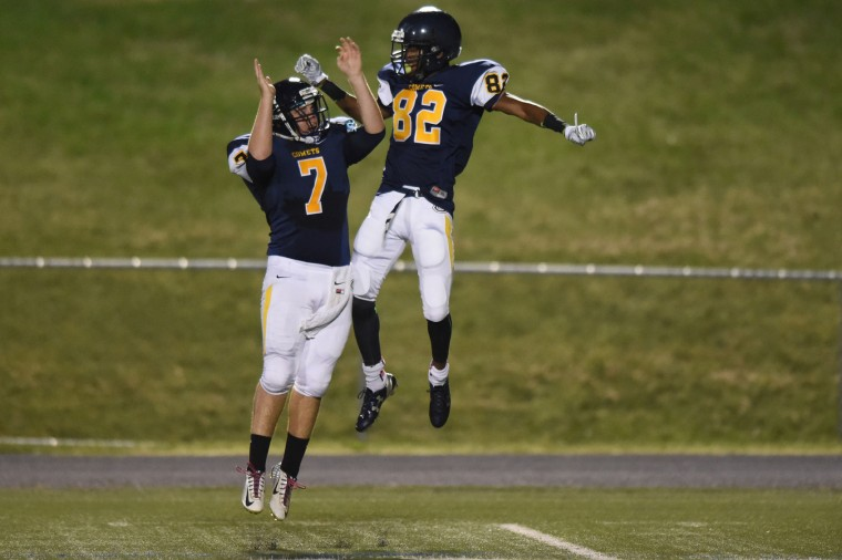 Catonsville quarterback Danny Terzi, left, celebrates a touchdown pass with receiver Malik Baker against Franklin during a football game at Catonsville High School on Friday, Sept. 25. (Brian Krista/BSMG)