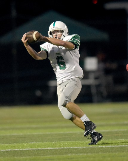 Arundel's Andrew Cassard catches a pass in the second quarter. The visiting Arundel Wildcats played the Old Mill Patriots in boys high school football Friday evening. (Paul W. Gillespie/Capital Gazette)