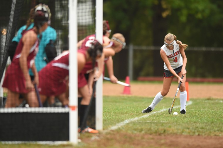 Dulaney's Calli Iouannou sends the ball in on a corner agaisnt Towson during a field hockey game at Dulaney High School on Tuesday, Sept. 29. (Brian Krista/BSMG)