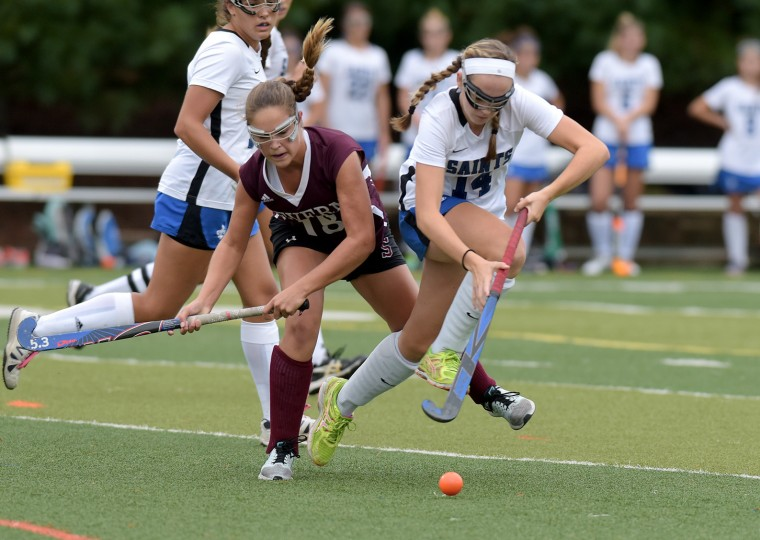 St. Mary's Caroline Feeley, right, gets the ball away from Severn's Sydney Kirchenheiter in the second half. The St. Mary's Saints defeated the visiting Severn Admirals, 3-1, in girl's high school field hockey Wednesday afternoon. (Paul W. Gillespie/Capital Gazette)