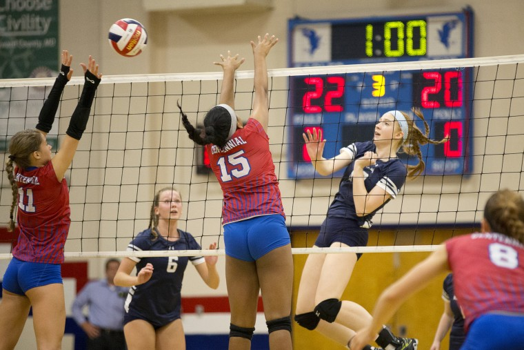Marriotts Ridge's Gabby Peitsch, right, tries to put the ball past Centennial's Camryn Allen, left, and Rachel Mathew during the third game of the volleyball match at Centennial High School in Ellicott City, MD on Thursday, October 1, 2015. (Jen Rynda/BSMG)