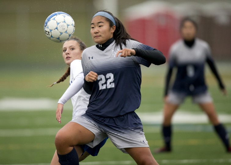 Marriotts Ridge's Jayme Choe, beats Centennial's Reese Western to the ball during the girls soccer game at Centennial High School in Ellicott City, MD on Thursday, October 1, 2015. (Jen Rynda/BSMG)