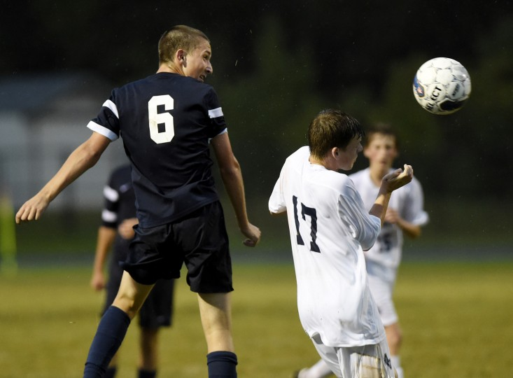 Francis Scott Key's Luke Luckenbaugh heads the ball past Manchester Valley's Dayne Koontz Tuesday, Sept. 29 in Manchester. (Dave Munch/Carroll County Times)