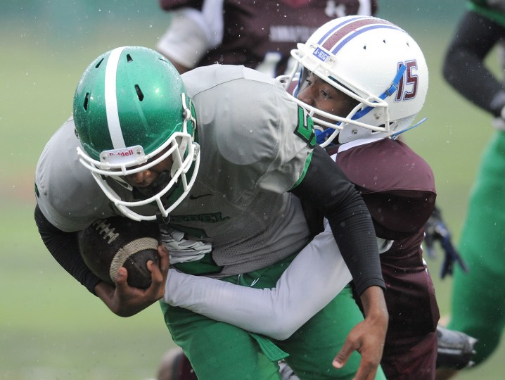 Annapolis' Nyonjae Spriggs takes down Arundel's Christian McFadden during Friday afternoons game at Arundel High School. (Matthew Cole/Capital Gazette)