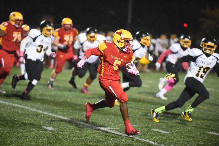 Calvert Hall's BJ Watson carries the ball in a sprint towards the sidelines against St. Frances during a football game at Calvert Hall's  on Friday, Oct 2. (Brian Krista/BSMG)
