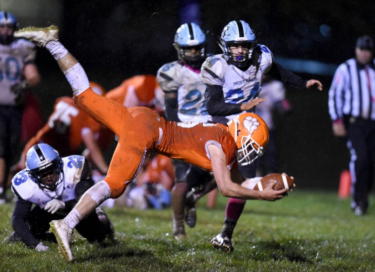 Fallston quarterback Andy Stump stretches for the goal line after having his feet knocked out from under him  by a C. Milton Wright defender on a run in Friday night's match up at Fallston. Stump would score and give the Cougars the lead 7-0 in the second quarter. (Matt Button/BSMG)