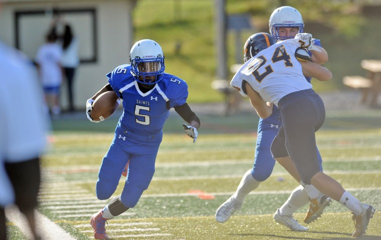 St. Mary's Isaiah Burke runs the ball in the game with St. Paul's in Annapolis. (Joshua McKerrow/Capital Gazette)