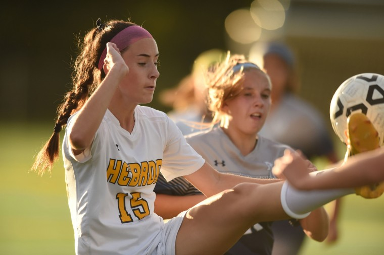 Mt. Hebron's Sydney Krell plays the ball with a high kick during a girls soccer game against Marriotts Ridge at Mt. Hebron High School in Ellicott City on Tuesday, Oct 6. (Brian Krista/BSMG)