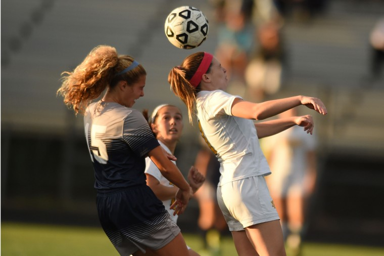 Mt. Hebron's Megan Holtzman, right, plays the ball with her head, beating Marriotts Ridge's Makenzie Hockensmith to the ball during a girls soccer game at Mt. Hebron High School in Ellicott City on Tuesday, Oct 6. (Brian Krista/BSMG)