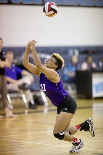 Pikesville's Owyn Otero dives for the ball during the second game of the volleyball match against Western Tech at Western School of Technology and Environmental Science in Catonsville, MD on Wednesday, October 7, 2015. (Jen Rynda/BSMG)