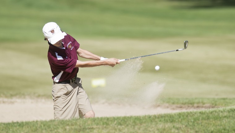 Broadneck's Luke Schwartz hits out of a sandtrap in the county golf championship at the Crofton Country Club. (Joshua McKerrow/Capital Gazette)
