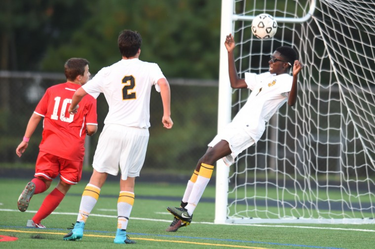 Mt. Hebron's Daniel Obeng uses his head to make a save while falling backwards towards the goal line during a boys soccer game against Centennial at Mt. Hebron High School in Ellicott City on Thursday, Oct 8. (Brian Krista/BSMG)