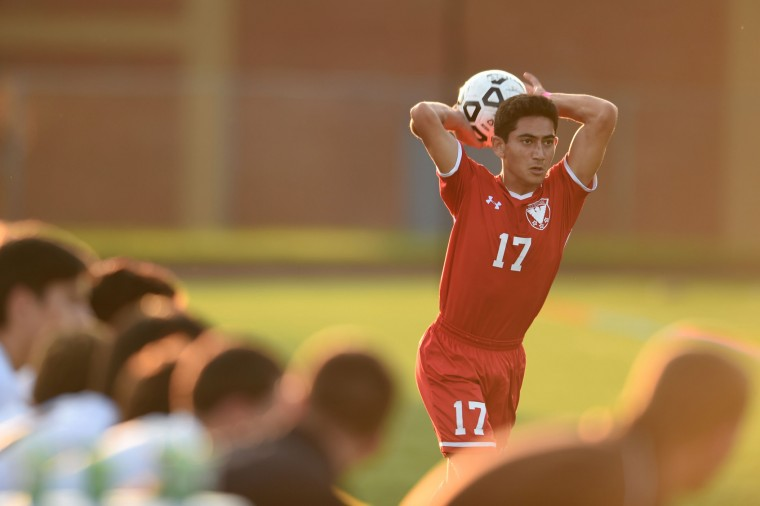 Centennial's Bobby Nasafi takes a throw-in during a boys soccer game at Mt. Hebron High School in Ellicott City on Thursday, Oct 8. (Brian Krista/BSMG)
