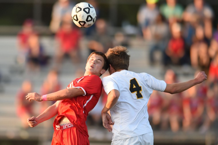 Centennial's Ammar Narmouq, left, collides with Mt. Hebron's Felix Dresner in the air as they both attempt headers during a boys soccer game at Mt. Hebron High School in Ellicott City on Thursday, Oct 8. (Brian Krista/BSMG)