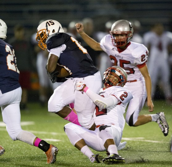 Reservoir's Daniel Huling, top, is brought down by Glenelg's Garrett Mills during the football game at Reservoir High School in Fulton, MD on Friday, October 9, 2015. (Jen Rynda/BSMG)