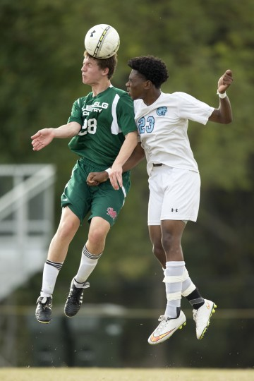 Glenelg Country School's Aidan Wisely, left, beats Pallotti's SJ Oyebadem right, to the ball during the boys soccer game at Fairland Regional Park in Laurel, MD on Friday, October 9, 2015. (Jen Rynda/BSMG)