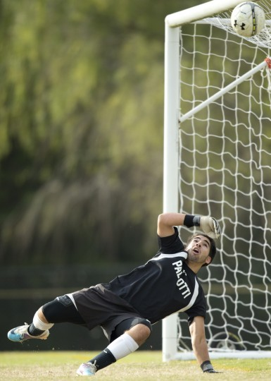 Pallotti goalie Jose Pesoa dives but misses on a Glenelg Country School goal during the boys soccer game at Fairland Regional Park in Laurel, MD on Friday, October 9, 2015. (Jen Rynda/BSMG)