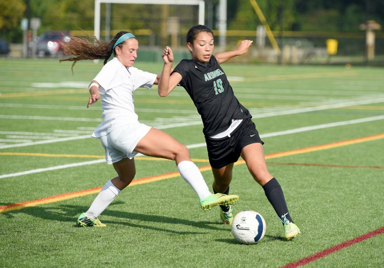 Arundel's Sara Davis, right, works the ball past Severna Park's Ryan Hussey in the first half. The visiting Arundel Wildcats played the Severna Park Falcons in girls high school soccer Thursday at Severna Park's temporary home field at Kinder Farm Park. (Paul W. Gillespie/Capital Gazette)