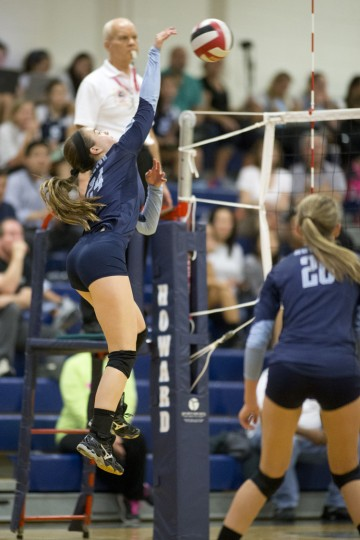 Howard's Sarah Sweet gets up for the ball during the first game of the volleyball match against River Hill at Howard High School, MD on Tuesday, October 13, 2015. (Jen Rynda/BSMG)