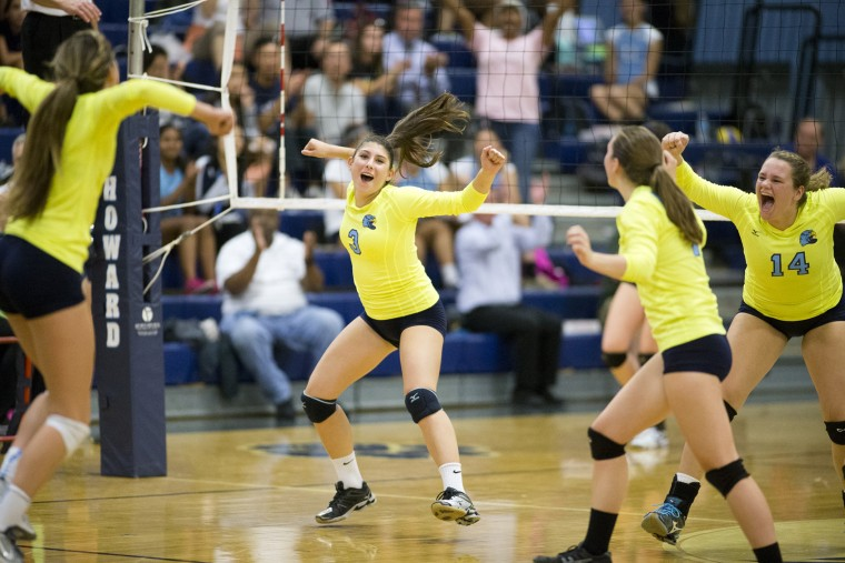 River Hill's Sammy Lala, center, celebrates winning the second game of the volleyball match against Howard with her teammates at Howard High School, MD on Tuesday, October 13, 2015. (Jen Rynda/BSMG)