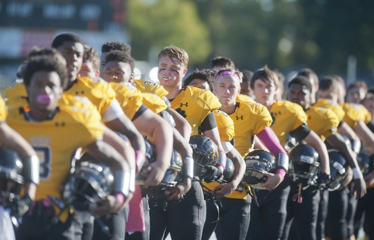 The Northeast Eagles line up for the playing of the National Anthem before the game with Chesapeake. (Joshua McKerrow/Capital Gazette)